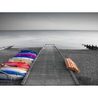 Assaf Frank - Kayaks on the side of pier