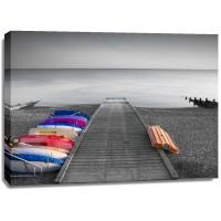 Assaf Frank - Kayaks on the side of pier
