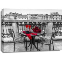 Assaf Frank - Bunch of Roses with wine glasses and female hand gloves on cafe table, Venice, Italy