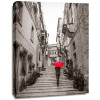 Assaf Frank - Tourist with umbrella in steps through houses in Birgu, Malta